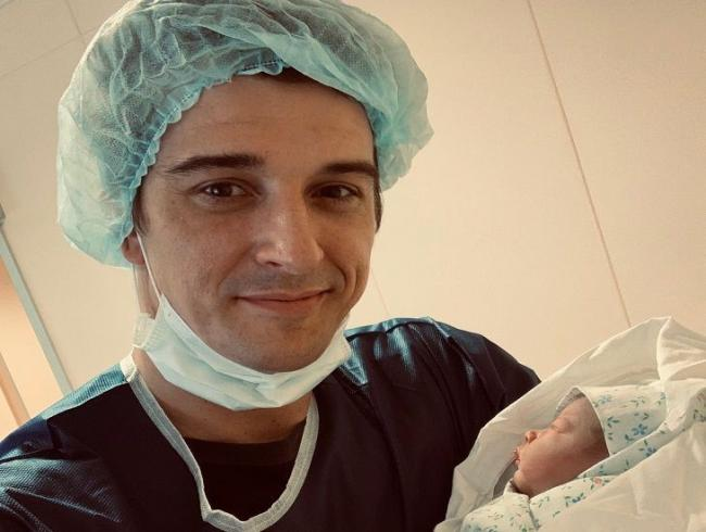Станислав Бондаренко с ребенком